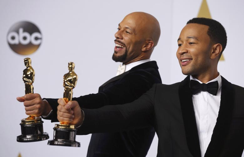 "Common and Legend take the stage to pose with their Oscars after winning the award for best original song for ""Glory"" from the film ""Selma"" during the 87th Academy Awards in Hollywood, California"