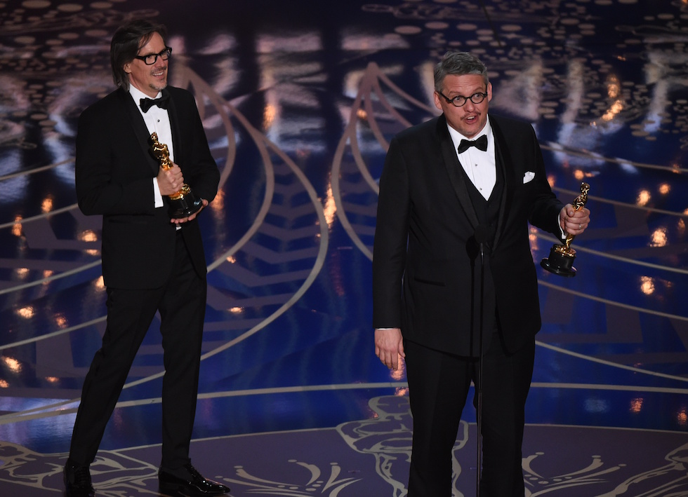Charles Randolph (L) and Adam McKay accep their awards for Best Adapted Screenplay, The Big Short on stage at the 88th Oscars on February 28, 2016 in Hollywood, California. AFP PHOTO / MARK RALSTON / AFP / MARK RALSTON (Photo credit should read MARK RALSTON/AFP/Getty Images)