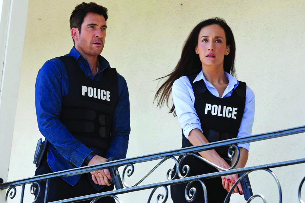 "TV STILL -- ""Manhunt"" -- When a bride is shot by a sniper during her wedding ceremony, Jack (Dylan McDermott, left) and Beth (Maggie Q, right) are called in to determine if her stalker has come back to haunt her, on STALKER Wednesday, Oct. 15 (10:00-11:00 PM, ET/PT) on the CBS Television Network. Photo: Michael Yarish/Warner Bros. Entertainment Inc. æ?¨© 2014 WBEI. All rights reserved."